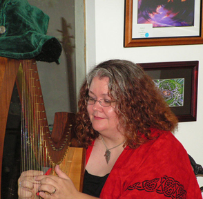 Gwen, playing the harp at the Phoenix & Dragon (photo)